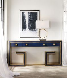 Not all ocean-inspired shades of blue are casual and beachy-as shown by the powerfully sleek, deep-sea blue of the Melange Greek Key Console.