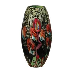 Features:  -Hand blown art glass.  -Collection: Malcolm Art Glass.  Product Type: -Table vase.  Shape: -Novelty.  Color: -Multi-Colored.  Primary Material: -Glass. Dimensions:  Overall Height - Top to
