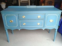 One of my favorite projects to date! Vintage buffet painted with ASCP in Aubusson Blue, with Old White details, and gold gilded hardware.