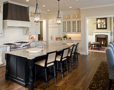 Like the island being a different color.  Great idea for a kitchen update!  (off-white perimeter with dark island)