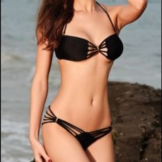 Yummy Bikini Set Black High fashion meets beach chic. Lined cups with light removable padding Removable halter strap Back closure Imported nylon/Lycra and spandex  new item available in small,medium,large sizes Swim Bikinis