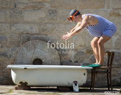 man in retro swimsuit jumps to the outdoor bathtub