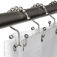 GENIUS!!! use a shower curtain as a curtain and use the second hook to hang blackout lining behind it (just add button holes).  Then just pull back the lining if you want more light to come in!