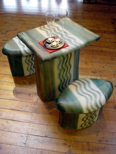 Ceramic stools and table complete with Christmas mince pies and mulled wine.  www.BoothHouseGallery.co.uk