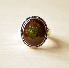 Gem Quality Fire Agate Ring - This stone is magical with its rainbow inclusions and detailed, hand crafted silver setting. www.villagesilversmith.net