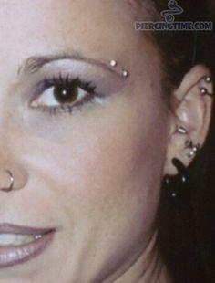 Horizontal eyebrow piercing