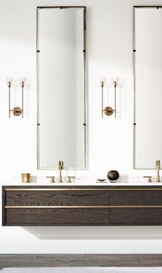 length of mirrors and shape of floating cabinets, but not brass for broderick