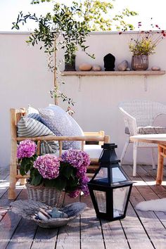 Outdoor seating  This outdoor area looks, rustic with unstained timber left to colour a beautiful grey, bamboo furniture & comfy cushions.It's relaxing & charming….a beautiful place to relax.