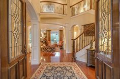 14 Balmoral Pl The Woodlands, TX 77382: Photo This home feels comfortable and spacious the moment you enter!  Extraordinary 20 ft Foyer, leaded glass, bright transoms, & walnut double doors!  Crown (double and triple) molding in most rooms. Arched doorways! Real wood floors! Plantation shutters!