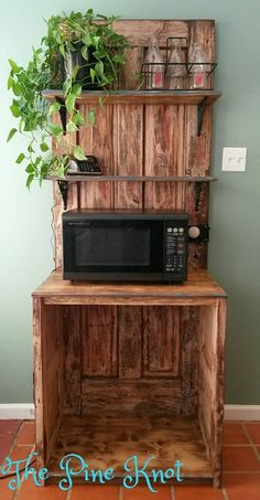 2 Old Doors transformed into a microwave stand with shelves. We salvaged the main door from an old building on my g… (With images) Recycled Furniture, Pallet Furniture, Microwave Stand, Microwave Cart, Microwave Shelf, Outdoor Kitchen Bars, Kitchen Redo, Kitchen Items, Kitchen Storage