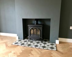 Parquet flooring & star tiled hearth in Living Room, Dark walls