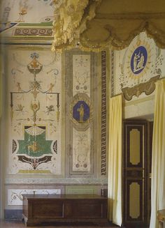 Polychrome painted grotesques based on designs from classical antiquity enrich the walls in a room at the Villa Mansi, at Segromigno, Lucca; the Neoclassic period decoration completed in 1792