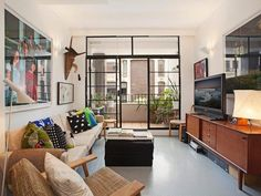Attracted to this look as it reminds me of my current apartment; narrow, large photograph dominating the room and glass sliding doors. Desire to Inspire