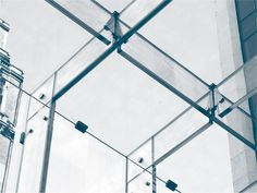Detail showing the reciprocating stainless steel connections for the glass beams supporting the roof of the Apple glass cube building in New York