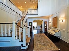 Love this.  Flooring color is great and staircase is beautiful.  Also love wainscoting.