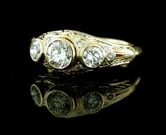Custom fabricated ladies 3 diamond ring with bezel setting in 14k yellow gold. Fillagree and hand etching