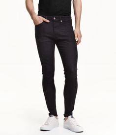 5-pocket low-rise jeans in washed stretch denim with ultra-slim legs and a button fly.
