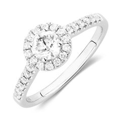 For the classically chic bride, there is nothing better than this 14kt white gold engagement ring, featuring 0.78 carat total weight of diamonds. With a round brilliant centrepiece, surrounded but a glittering halo, the elegant look is finished with diamonds claw set into the shoulders to create a piece worthy of symbolising the love you share.