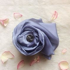 Introducing our Luxé Satin Silk Ash Blue, the latest addition to our satin silk family. Restocking tomorrow, satin silk range now comes with new, fresher colours, with better quality and beautiful luxurious basic satin. This one's a true beauty! -  #donutscarvesmalaysia #donutscarves #flatlay #donutscarvesflatlay #hijab #scarf #scarves