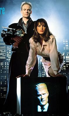 Edison Carter (Matt Frewer in Max Headroom) and Amanda Pays