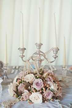 Vintage candelabra draped in pearls