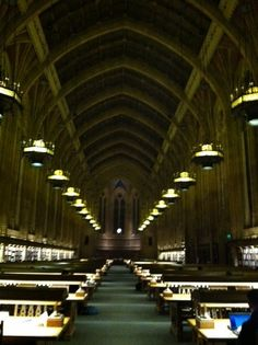 Students enjoying the atmosphere of the Suzzallo reading room at night. #youW Photo by Susan Griffith