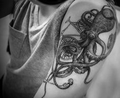 Octopus tattoo on the arm. Love all the little things that are added in with the octopus.  Makes the tattoo that much cooler.