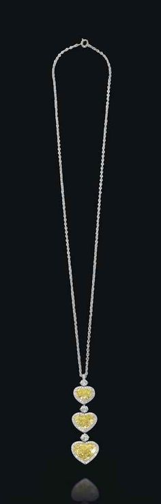 A necklace with three graduated heart-shaped fancy vivid yellow diamonds #christiesjewels