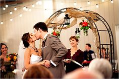 strawberry farms wedding venue arch with hanging vases flowers