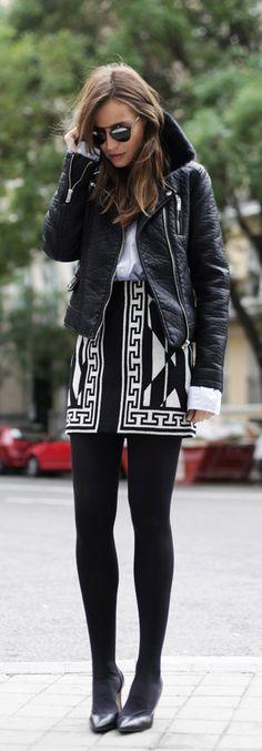 Silvia Zamora is wearing a black shearling trim leather jacket from Zara