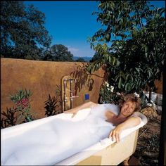 homeowners turn a vintage tubs into outdoor tub & hot tubs :)