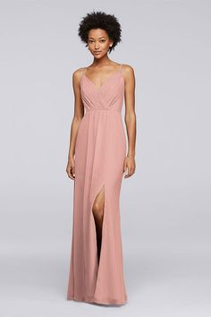 Delicate beaded straps and a pleated bodice make this long pale pink chiffon bridesmaid dress as pretty as can be. Explore more embellished bridesmaid styles at David's Bridal.