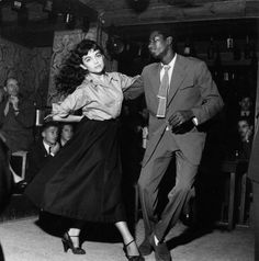"A couple dancing in a 1950's ""Be Bop"" theater as everyone looks on."