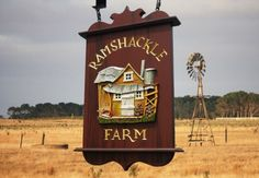 This unique farm sign's focal point is the whimsical sculpted shack. Juxtaposed with carved and gilded text, it makes an unmistakeable impression. Farm Signs, Pub Signs, Wood Signs, Shop Signage, Signage Design, Property Signs, Sign Board Design, Old Pub, Garden Signs