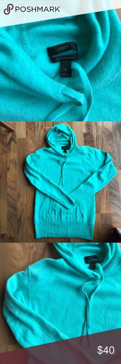 """J.Crew Cashmere Hoodie J.Crew Cashmere Hoodie in light green. I absolutely love this hoodie but is just to small on me. It is so soft and comfy. Color has been hard to capture despite trying several different lighting areas! It is a really pretty light green, looks kinda blue in picks. Minor signs of pilling on the side underarms but otherwise excellent condition. I would say it runs a tad small, closet to a small than a medium. Shoulder to hem approx 24"""", pit to pit approx 15-1/2"""". J. Crew…"""
