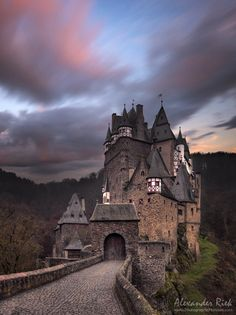 Eltz Castle (German: Burg Eltz) is a medieval castle nestled in the hills above the Moselle River between Koblenz and Trier, Germany. It is still owned by a branch of the same family that lived there in the 12th century, 33 generations ago. The Palace of Bürresheim (Schloss Bürresheim), the Castle of Eltz and the Castle of Lissingen are the only castles on the left bank of the Rhine in Rhineland-Palatinate which have never been destroyed (by Alexander Riek)
