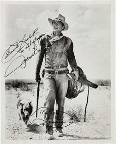 A John Wayne Signed Black and White Photograph, 1970s