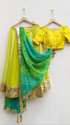 Comes with traditional bandhej Dupatta in green turquoise and yellow, with golden lappa border and Gota Tassels Half Saree Designs, Choli Designs, Lehenga Designs, Saree Blouse Designs, Mehndi Designs, Indian Wedding Outfits, Indian Outfits, Bridal Outfits, Indian Dresses