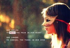 She smiles to mask the pain in her heart. She laughs to conceal the tears in her eyes.