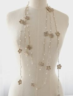 DIY inspiration - LOVE this! Take a cue from Jolanta Beinarovica and create your very own whimsical necklace using white glass pearls, linen thread, and crochet hooks. Get tips and techniques from the master in Jewelry Affaire.Feature on Jewelry Affa Colar Lariat, Lariat Necklace, Bead Crochet, Crochet Necklace, Crochet Hooks, Jewelry Crafts, Handmade Jewelry, Light Scarves, Crochet Accessories