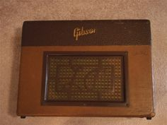 """'52 GA-40 Les Paul  : The first Les Paul amp, issued the same year as the guitar, the GA-40 had the new 50's two-tone look and square grille with script """"LP"""", many of which have not survived.  It employs 6V6's like almost all Gibsons."""