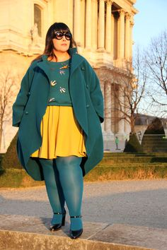 Another yellow-teal combo, this time with awesome birds, both on the sweater design and in the pins. I adore the coat, too.