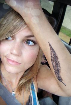 Feather Tattoo... I really love it! But I dont think I'd get it because what if Feathers go out of style??