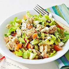 Greek Salad with Tuna In a large bowl, whisk together 2 teaspoons olive oil, 2 teaspoons red wine vinegar, 1/2 teaspoon dried oregano, and salt and pepper to taste. Toss with 3 cups chopped romaine, 2 1/2 ounces water-packed tuna, 1/2 cup diced cucumber, 1/2 cup diced tomato, 1/2 cup cooked whole-grain couscous, 1 tablespoon crumbled feta, and 4 chopped Kalamata olives.