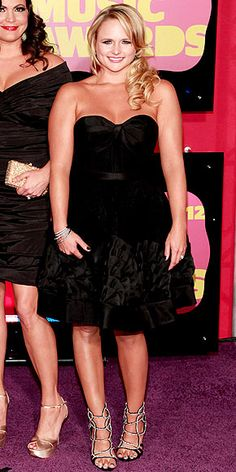 """Miranda Lambert (pictured) has been quoted asking her husband why he didn't tell her she was fat at the time this photo was taken. Clearly this woman is not fat, and looks to be healthy, even athletic looking. It is clear why so many individuals develop eating disorders, when we have such a warped perception of what """"healthy"""" and """"thin"""" are."""