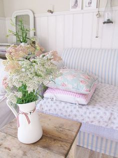 A Beautiful Jug Of Flowers In A Shabby Little Living Room