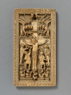 The Crucifixion - ivory panel, probably a book cover made in Rheims, France (860-870),  V&A