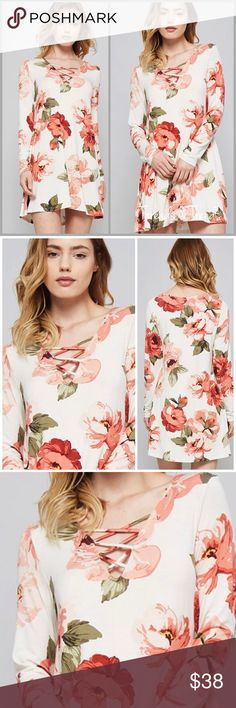 Criss Cross Floral Tunic Dress Get the flower power trend this season. Ivory tunic dress with coral, peach and sage floral print. Also featuring a V Neck criss cross neckline. Made of rayon and spandex. Sizes S, M, L Threads & Trends Dresses
