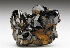 Exceptionally lustrous well-formed dark brown crystals of Cassiterite from Horni Slavkov, Czech Republic. Crystal Classics Minerals