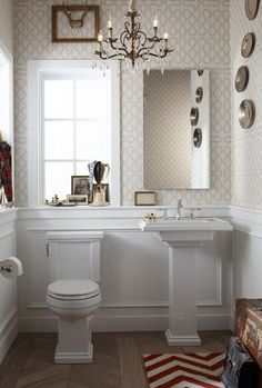 bathrooms - Kohler Tresham Pedestal Sink red white zigzag chevron rug herringbone wood floors white pedestal sink wainscoting beige wallpaper bronze crystal chandelier